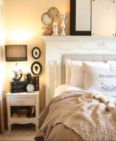 Creative Fireplace Headboard - this one has been upholstered in the middle and the mantle is a perfect spot for collectibles.