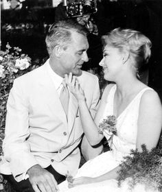 Cary Grant and Kim Novak at a party in Cannes. May, 1959