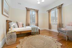 round jute floor rug on polished timber floor boards