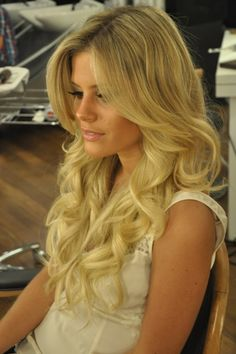 Gorgeous! Just use a bigger curling iron about 1 1/4 in and run fingers through