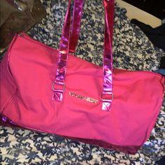 VICTORIA SECRET Duffle Bag! Super cute Large Pink Duffle Bag. It's in Excellent condition! Large shoulder straps and cute lined interior!  Victoria's Secret Bags