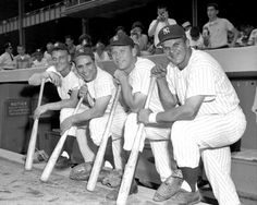 Roger Maris, Yogi Berra, Mickey Mantle and Moose Skowron (l.-r.) line up to power the Yabnkees to a doubleheader sweep of the Tigers at the Stadium.