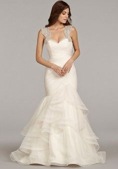 Ivory English net fit to flare bridal gown with ruched detailing on bodice, double horsehair trim flounced skirt, alabaster and crystal encrusted keyhole…