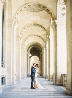 A kiss at the historic monument at the Louvre Palace: http://www.stylemepretty.com/little-black-book-blog/2016/09/12/elegant-chic-parisian-engagement-shoot/ Photography: Oliver Fly - http://oliverfly.com/