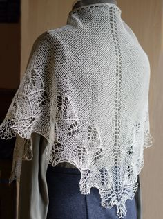 """Supersoft and feather light! Made from beige luxurious cashmere and silk blend yarn with a feathery pattern.  It will add that little extra luxury feeling even with the simplest dress. It shimmers and reflects the colors around it due to the silk content.   This super elegant little triangle shawlette was hand knit by me. Ready to ship! ---------------------------- Measurements are: width 56"""" (140cm), length 20"""" (50cm) Weight only 0.88 oz (25g)."""