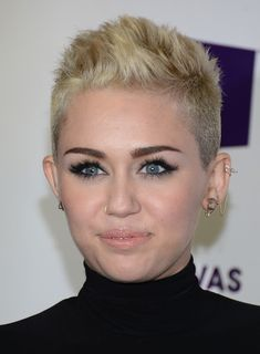 Miley Cyrus Beauty  Why is everyone so down on her? She's young, Ri$h, & BEAUTIFUL!!! Be NICE !!! Wish I had the balls...