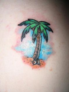 Small colorful tattoo with palm tree