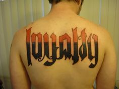 Big Loyalty Ambigram Tattoo On Back