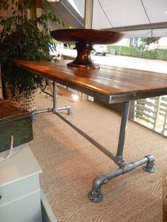 Dining table using salvaged scaffold poles and planks athttp://namasteinteriors.wordpress.com/2013/09/16/love-reclaimed/