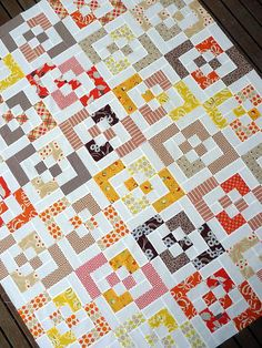 Bento Box Scrap Quilt - Surprisingly enough, the Bento Box Scrap Quilt is an easy quilting pattern that even a beginner can create. By creating 30 super simple square-in-a-square quilt blocks before cutting them into quadrants and rearranging them, this scrappy idea uses small pieces of fabric, making it the perfect creation to bust that stash of yours. The final quilt top is perfect for a twin bed accent.