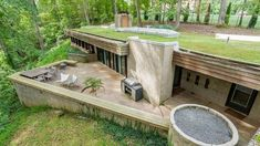 Donald Reed Chandler-designed underground property in McLean, Virginia, USA Bunker Home, Earth Sheltered Homes, Earthship Home, Eco Buildings, Take Shelter, Underground Homes, Underground House Plans, Earth Homes, Modern House Design