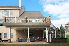 From the lovely elevated deck to the spacious ground level patio, this project perfectly displays a great combination of defined hardscaping and elegant decking Deck Shade, Outdoor Shade, Patio Deck Designs, Patio Ideas, Backyard Ideas, Two Level Deck, Second Story Deck, Covered Patio Design, Deck Posts