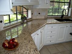 Remodeling Kitchen Countertops Especially limited spaced kitchen remodeling catches Giallo Napoli Granite White Cabinets Backsplash Ideas.It is warm and frolic in spacious kitchen too. Outdoor Kitchen Countertops, Granite Kitchen, Granite Countertops, Kitchen Redo, Kitchen And Bath, New Kitchen, Kitchen Ideas, Kitchen Things, Wooden Kitchen