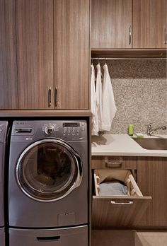 A hanging rod for drying is a must today and adds useful function to the laundry room. By positioning this over the sink area, wet items hung up are less likely to soak other areas of the room.