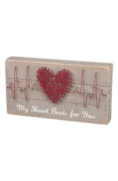 Free shipping and returns on Primitives by Kathy Skip a Beat String Art Box Sign at Nordstrom.com. Natural string is wrapped around silvery nails to form a cute EKG heart design on a rustic wooden box sign stamped with the words 'My Heart Beats For You.'