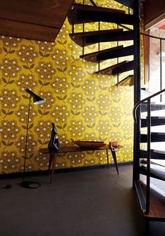 70's colours brown and mustard yellow look great in this wallpaper by Orla Kiely.