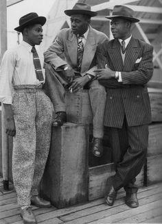 Three Jamaican men on board the Empire Windrush arriving at Tilbury Docks, 1948.