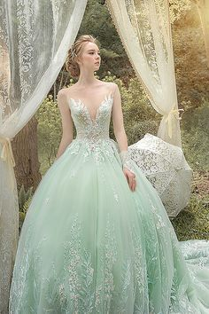 9250554deeba We cannot resist this refreshing green ball gown from Bella Wedding Dress  featuring delicate floral embroideries!
