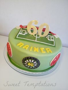 60th birthday cake -  Birthday cake for a soccer and darts fan ;) Cake is filled with vanillasponge and raspberry cream.