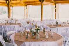 wedding reception white chair and brown linens outdoors