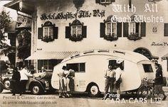 This Christmas postcard, stamped 19 Dec 1943, shows a German registered Mercedes tourer towing a British caravan.