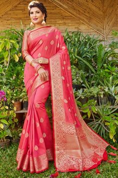 Carrot Pink banarasi silk saree with carrot pink silk blouse, embellished with woven zari. Saree with Round Neck, Elbow Sleeve. It comes with unstitch blouse, it can be stitched 32 to 44 sizes. #carrot pink #banarasi silk #saree #blouse #Andaazfashion #UK