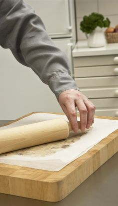 ROLLING OUT. Roll thin crusts between two sheets of SAGA paper with ease. Thin Crust, Crusts, Saga, Rolls, Canning, Paper, Wood, Woodwind Instrument, Buns