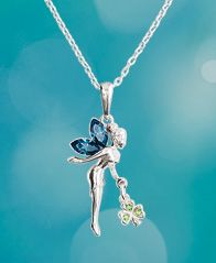 Fairy with Shamrock Pendant - A wee fairy has brought you a surprise! Her wings sparkle with deep blue crystals as she dangles her gift - a little silver shamrock, shining with tiny green crystals.