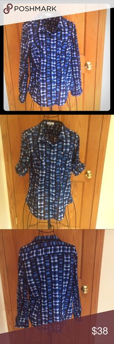 """💐SALE💐Calvin Klein Button Down Shirt Calvin Klein button down shirt with a trendy blue, white, and black pattern. Flap pockets one on each side with buttons. Roll tab sleeves so you can wear long or short sleeve. Lightweight, 100% cotton. Measurements approximately as follows: bust 40"""", length 27"""" and sleeves 24"""". EUC. Calvin Klein Tops Button Down Shirts"""