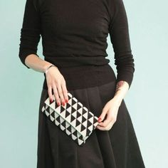 Crochet a modern black and white evening bag with this tutorial