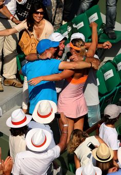 Maria Sharapova of Russia celebrates with her team folloowing her victory in her women's singles final match against Simona Halep of Romania on day fourteen of the French Open at Roland Garros on June 7, 2014 in Paris