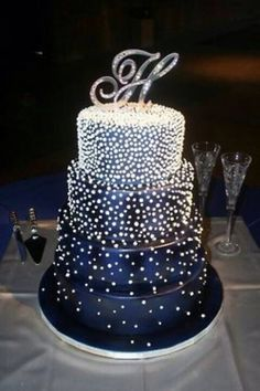 This the wedding cake I want. Dark navy blue, with little crystal things. Goes with my theme.