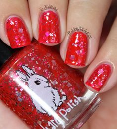 "From Hare Polish: ""Leap Light-year"" has silver glitter in a bright red jelly base."