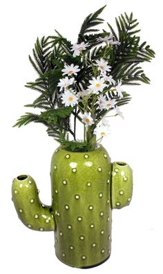 A sunny centerpiece inspired by the flora of the Southwest. Cactus Vase…
