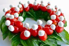 Christmas Wreath. Mozzarella balls, cherry tomatoes and basil. cherri, salad, christmas parties, christma wreath, christmas wreaths, holiday parties, vegetable trays, tomato, christmas appetizers