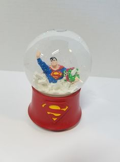 Musical Christmas Water Globe. 6 1/2 inches tall 5 inches wide. Superman holding a present for lois surrounded by fortress crystals.Superman Stuff is your one stop shop for all things Superman, straight from the Home of Superman, Metropolis, IL. We also carry a variety of other superhero products! Follow us on social media @supermanmuseum