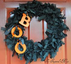 Cute  Halloween Wreath Idea: Tie bits of black fabric around a wire wreath frame and then attach orange (or lime green, or purple, or silver, or white, etc.) letters!