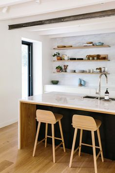 Floating Shelves, Marble Countertops and Backsplash and Black Hood are Gorge!