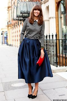 A masterclass in styling a full, midi skirt and stripes.