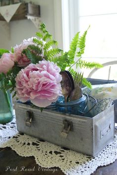 Blooms...and a pretty way to display a vintage lunchbox.