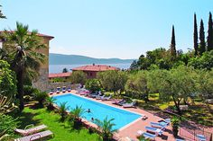 Hotel Livia - Gargnano ... Garda Lake, Lago di Garda, Gardasee, Lake Garda, Lac de Garde, Gardameer, Gardasøen, Jezioro Garda, Gardské Jezero, אגם גארדה, Озеро Гарда ... Welcome to Hotel Livia Gargnano. Hotel Livia is a family-run hotel with large park and swimming-pool. About 100 mt. from the beach. Every room with full amenities, private bathroom, direct dial telephone, colot Tv-Sat, minibar. Private car park. Buffet breakfast. Tennis, golf, sailing an