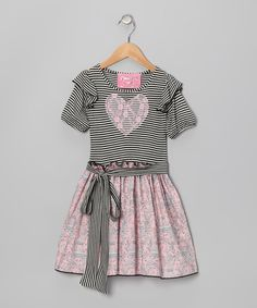 Any charming chickadee will love this frock that flaunts a sash around the waist and a stretchy fit for comfort. An enchanting Eiffel Tower-embellished skirt and ruffled sleeves add an extra bit of flair and fancy.Bodice: 95% cotton / 5% spandexSkirt: 100% cottonMachine wash; tumble dry