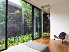Image 26 of 29 from gallery of The Space Between Walls / HYLA Architects. First and Second Floor Plans Interior Design Singapore, Home Interior Design, Timber Staircase, Small Balcony Design, Internal Courtyard, Bungalow House Design, Interior Garden, Modern House Plans, Residential Architecture