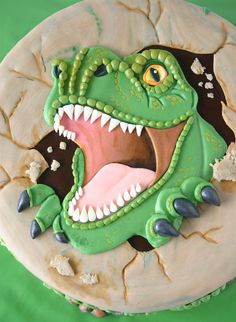 Amazing T-rex dinosaur face cake