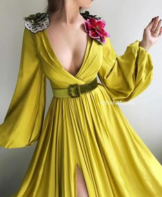 Details - Lemon dress color - Silk dress fabric - Embroidered flowers on shoulders and a green velvet belt - A-line dress with long sleeves, V-neck and waist definition and an open leg - For parties and special events Evening Dresses, Prom Dresses, Yellow Fashion, African Attire, Couture Fashion, Fashion Hub, Dream Dress, Silk Dress, Pretty Dresses