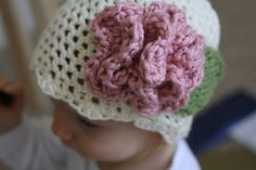 Ravelry: Baby Hat Cream with Pink Accent Flower pattern by Jessica Zoz