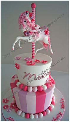Carousel Horse Cake design featuring a sugarcrafted carousel horse and child's name both decorated with crystal diamonties. Price $710