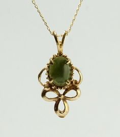 In #CherryOrchardAttic on #Etsy Vintage 14K Yellow Gold Green Jade Cabochon Bow Pendant Necklace #jewelry #jadejewelry #jade #green #greenjade #jadependant #jadenecklace #nephrite #jadeite #vintagejewelry #finejewelry #Bows
