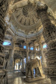 Ranakpur Temple, Rajasthan, India.  Unimaginably exquisite and unique carvings on white marble surface of 2000 or so pillars everywhere you look.  Saw this temple before the vaunted Taj; made Taj Mahal seem rather sparse!