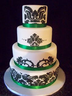 A beautiful cake with damask detail and emerald green ribbon